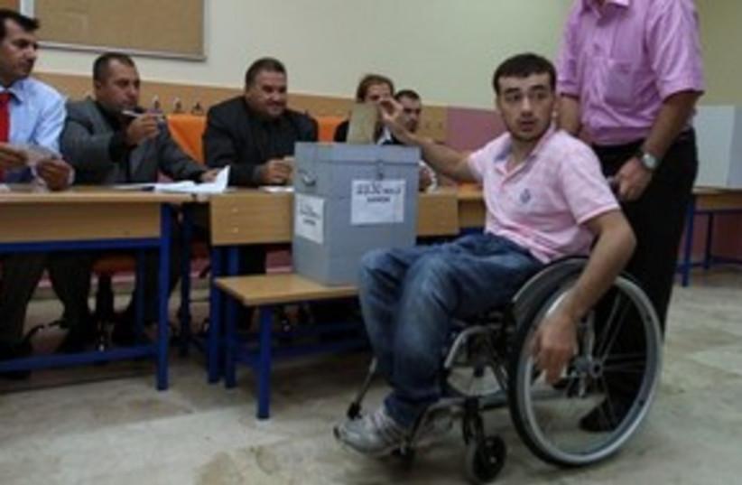 Turkish man in wheelchair votes 311 (photo credit: AP Photo/Burhan Ozbilici)