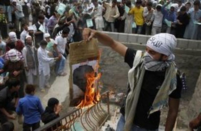 311_burning terry jones (photo credit: Associated Press)