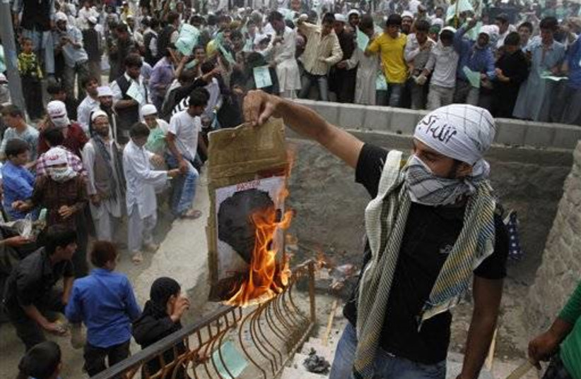 Afghan protester burning photo of Rev. Terry Jones