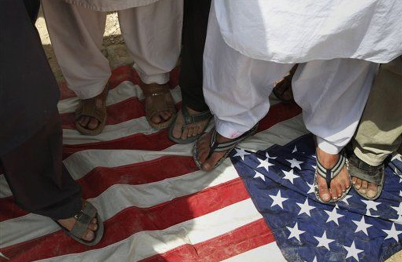 Afghan protesters stomping on American flag.