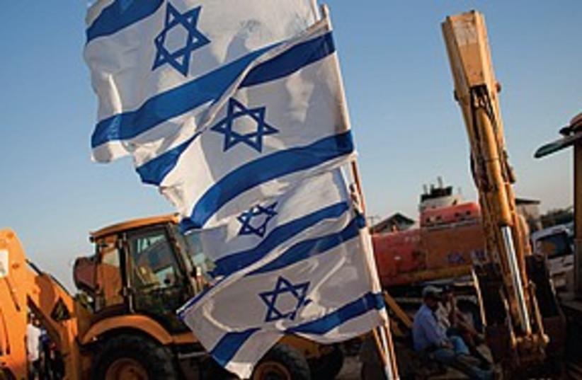 Settlement building ceremony (photo credit: Associated Press)