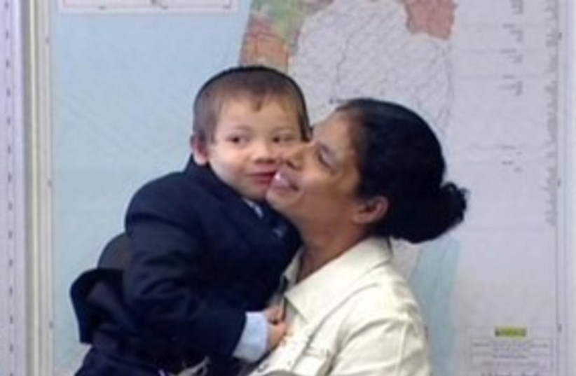 Mumbai nanny smiling with boy 311 (photo credit: Channel 10)