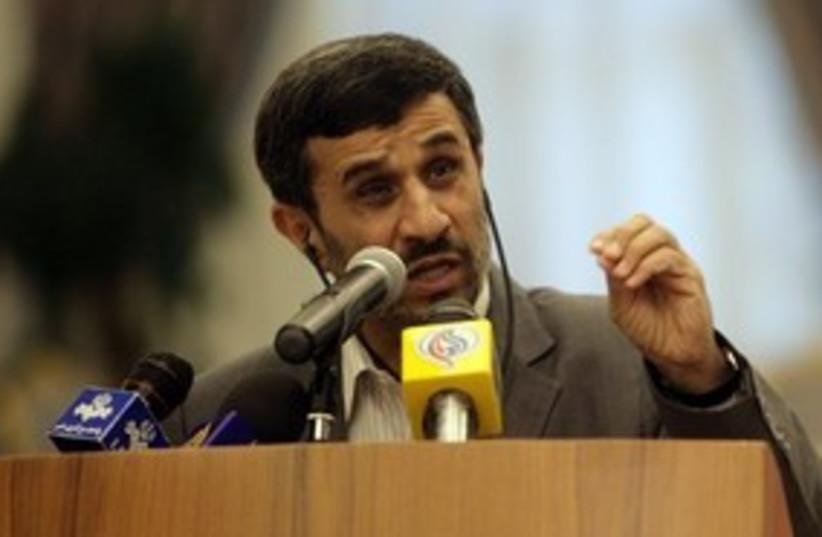 Ahmadinejad speaking to press, squinting 311 (photo credit: AP Photo/Osama Faisal)