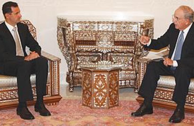 Mitchell and Assad (photo credit: Associated Press)
