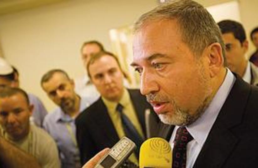 Lieberman talks to press (photo credit: Pool/Haaretz, Tal Cohen)