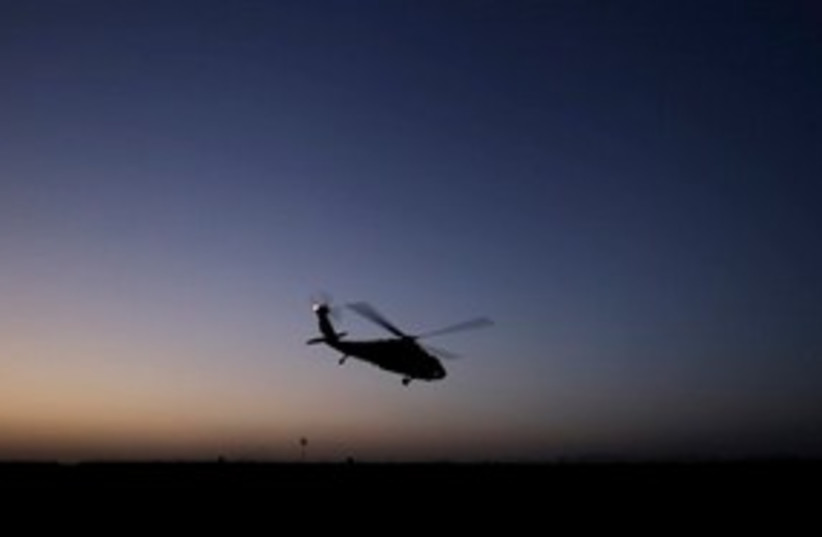 Afghan helicopter at night 311 (photo credit: AP Photo/Brennan Linsley)