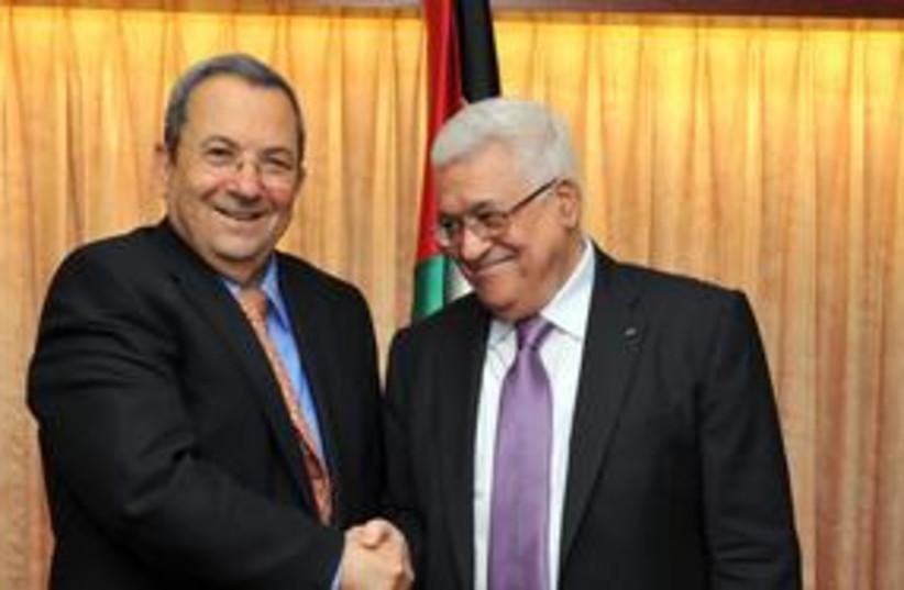 Barak and Abbas shaking hands 311 (photo credit: Ariel Harmoni, Defense Ministry)