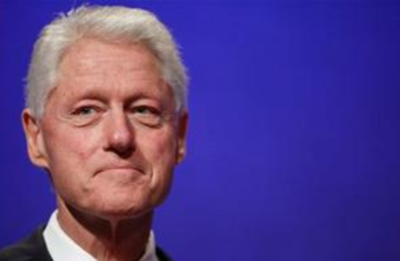 Bill Clinton kind of smiling 311 (photo credit: AP Photo/Mark Lennihan)