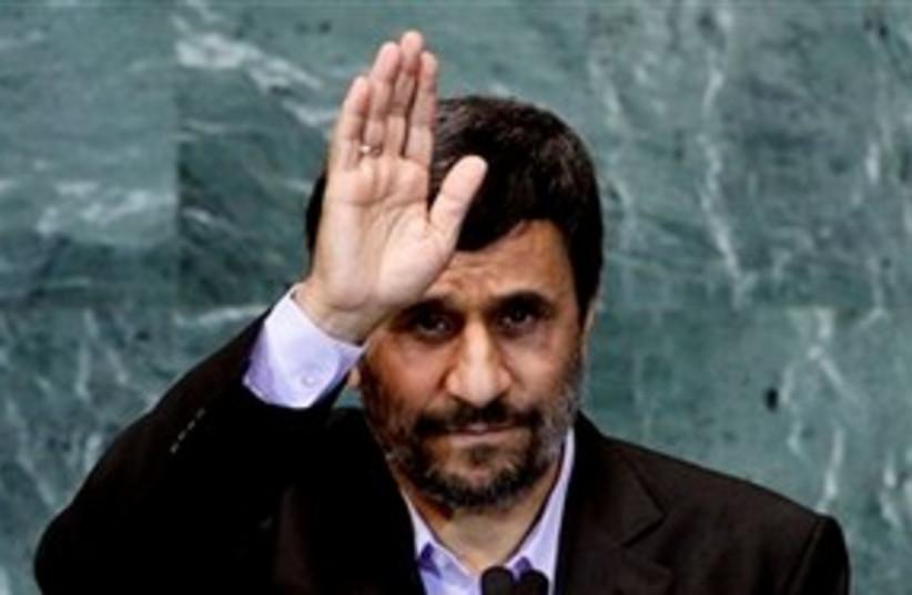 Ahmadinejad Salutes 311 (photo credit: Associated Press)
