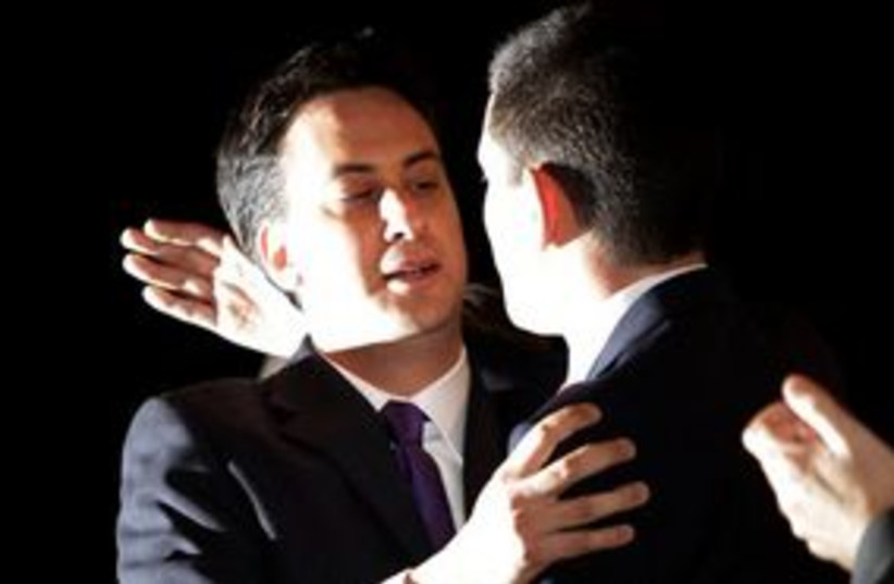 Ed Milliband hugs brother 311 (photo credit: AP Photo/Lefteris Pitarakis)