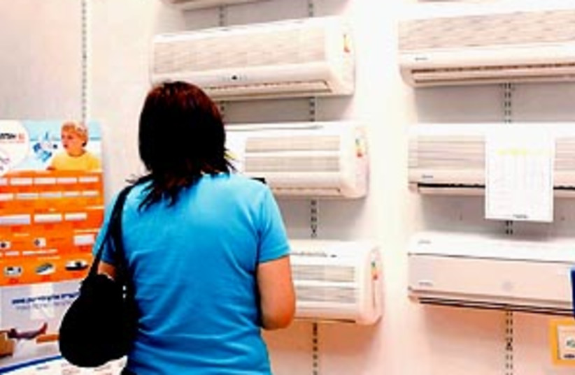 A woman shopping for air conditioners (photo credit: Ariel Jerozolimski )