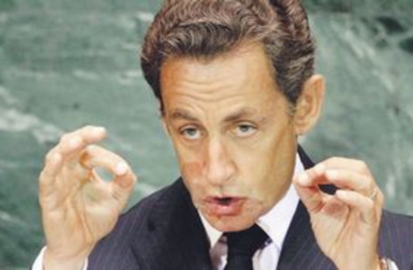 311_sarkozy making donut holes (photo credit: Associated Press)