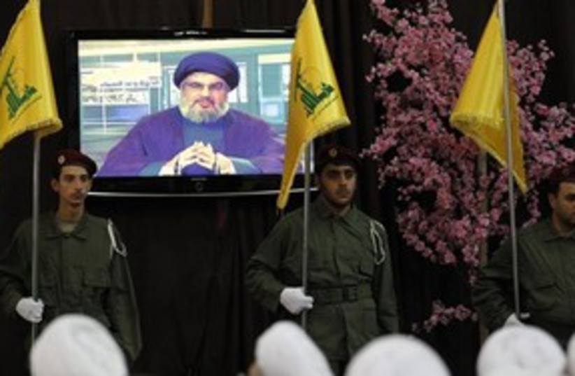 Hizbullah Nasrallah on TV 311 AP (photo credit: Associated Press)