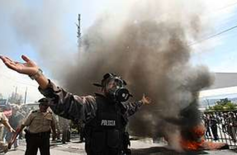 Police demo Ecuador (photo credit: Associated Press)