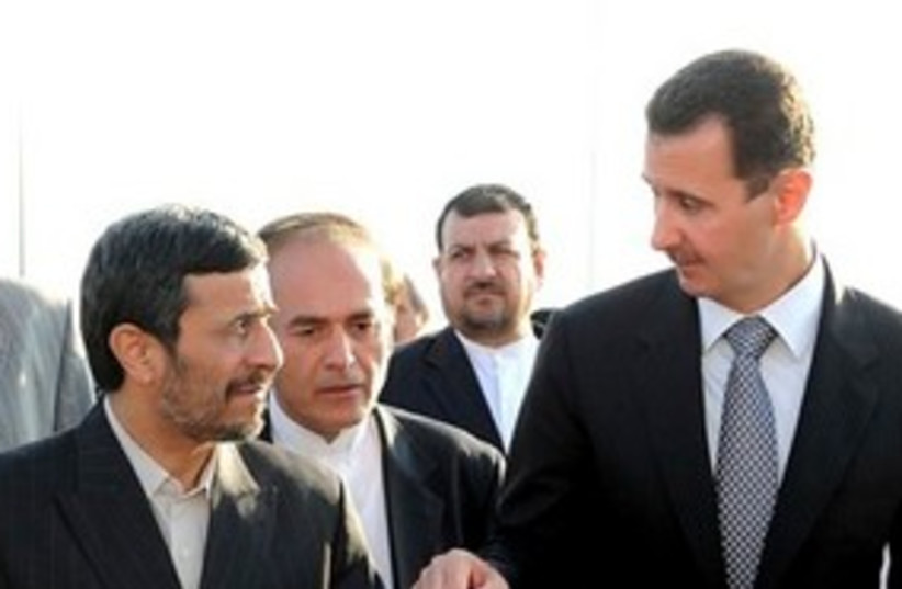 Assad and Ahmadinejad meeting 311 (photo credit: AP Photo/ Sana-HO)