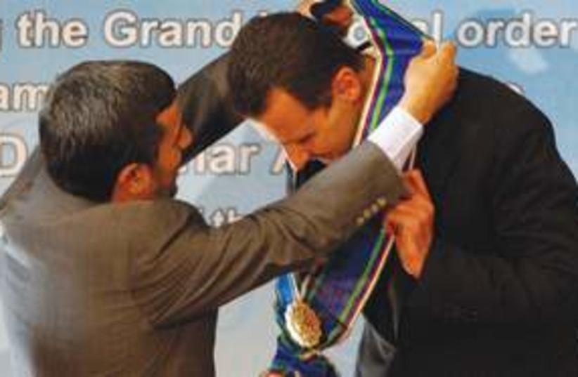 Assad Ahmadinejad Medal 311 AP (photo credit: Associated Press)