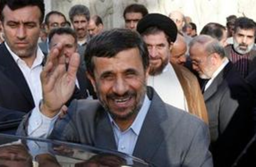 Ahmadinejad smiling, waving 311 (photo credit: AP Photo/Vahid Salemi)