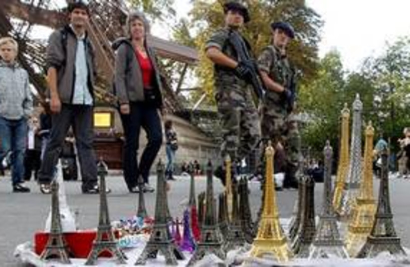 311_French defending their souvenirs from tourists (photo credit: Associated Press)
