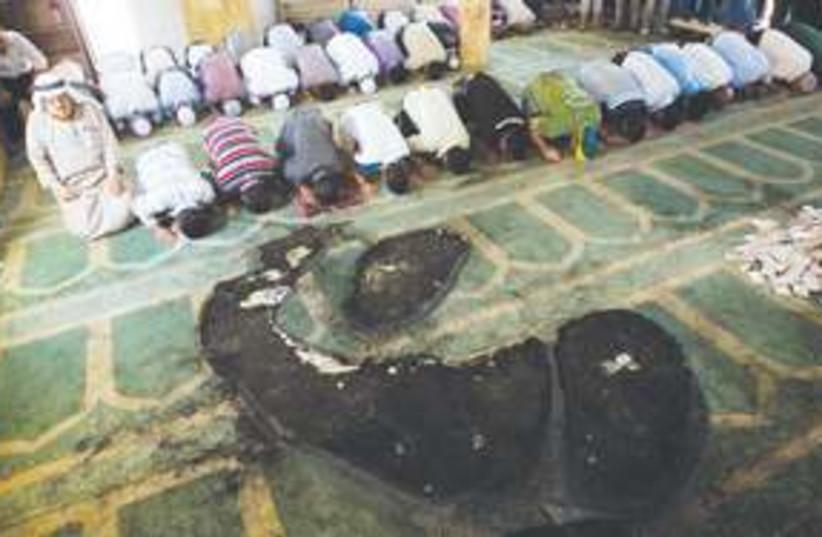 311_burn mosque (photo credit: Associated Press)