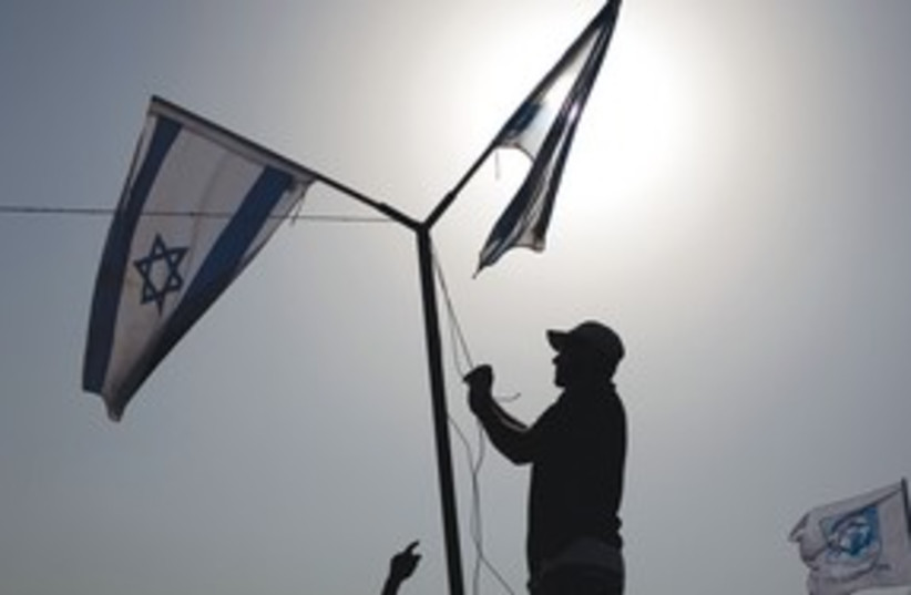 Israeli Flags 311 (photo credit: ASSOCIATED PRESS)