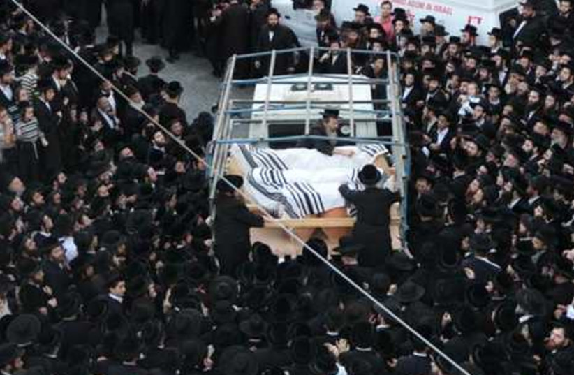 Thousands gather at Torah scroll funeral