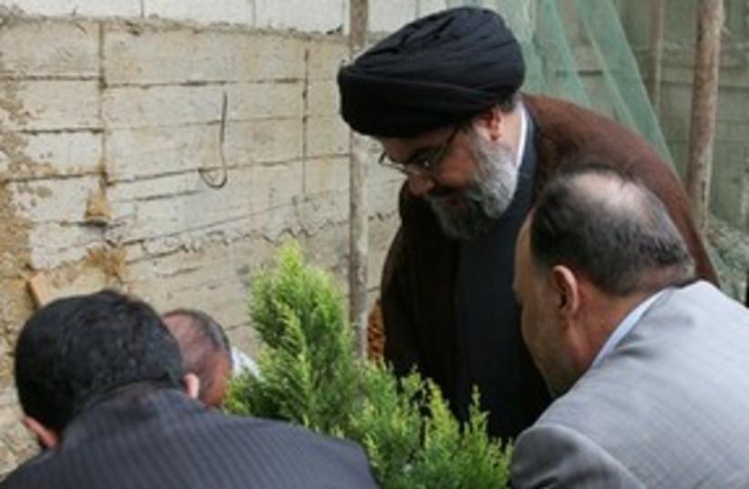 Nasrallah planting tree 311 AP (photo credit: AP)
