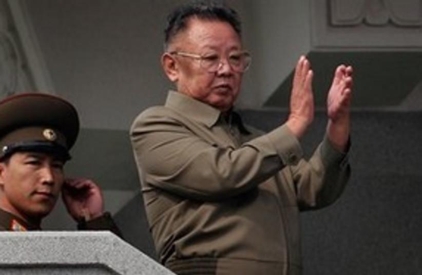 311_Kim Jong Il with son Un (photo credit: Associated Press)