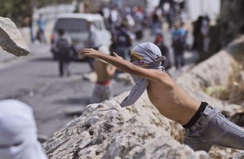 MASKED Palestinian youth 311 (photo credit: AP)
