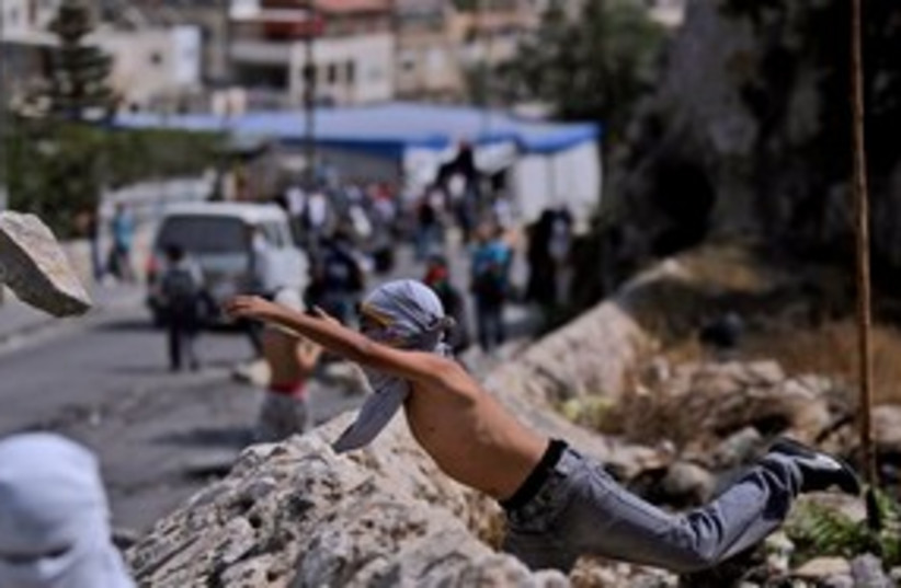 Throwing rocks in silwan 311 AP (photo credit: Associated Press)