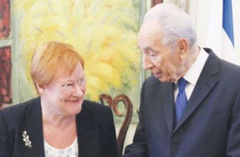 Peres with Finnish president 311 (photo credit: Associated Press)