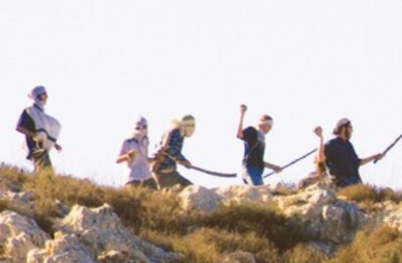 settlers throwing rocks 311 (photo credit: Btselem)