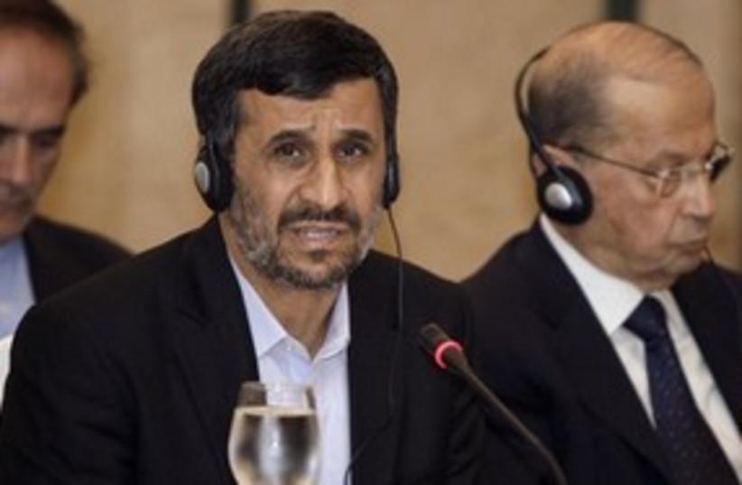Ahmadinejad cool headphones 311 AP (photo credit: Associated Press)
