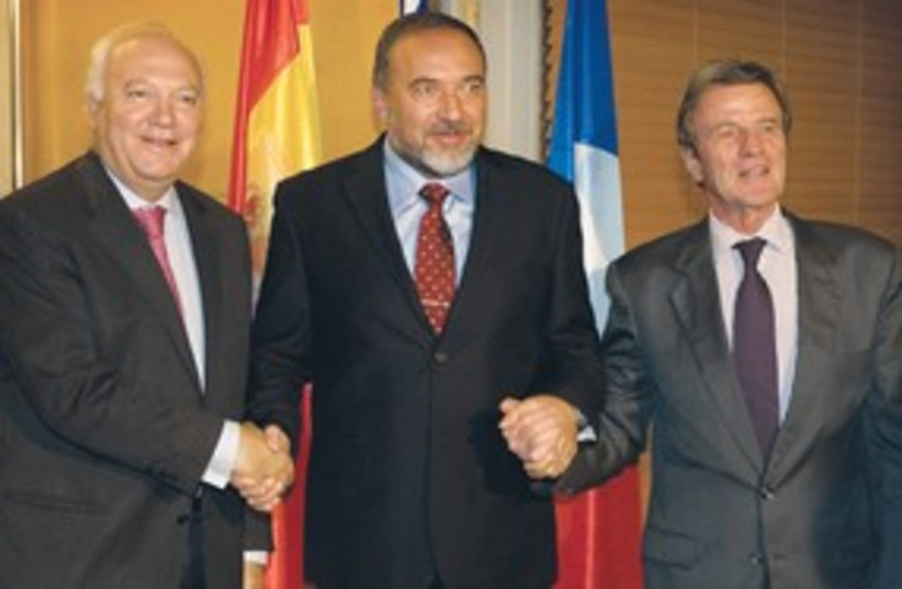 Lieberman holding hands with Kouchner & Moratinos 311 AP (photo credit: AP)