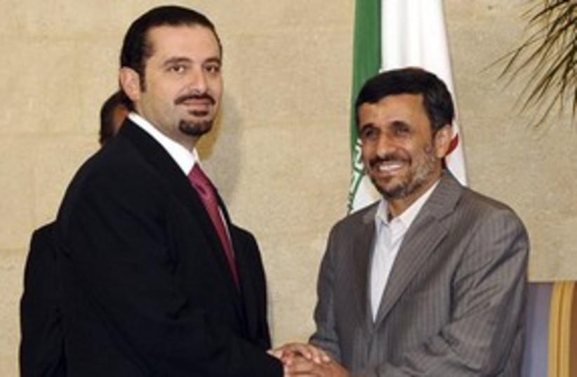 Hariri and Ahmadinejad 311 AP (photo credit: AP)