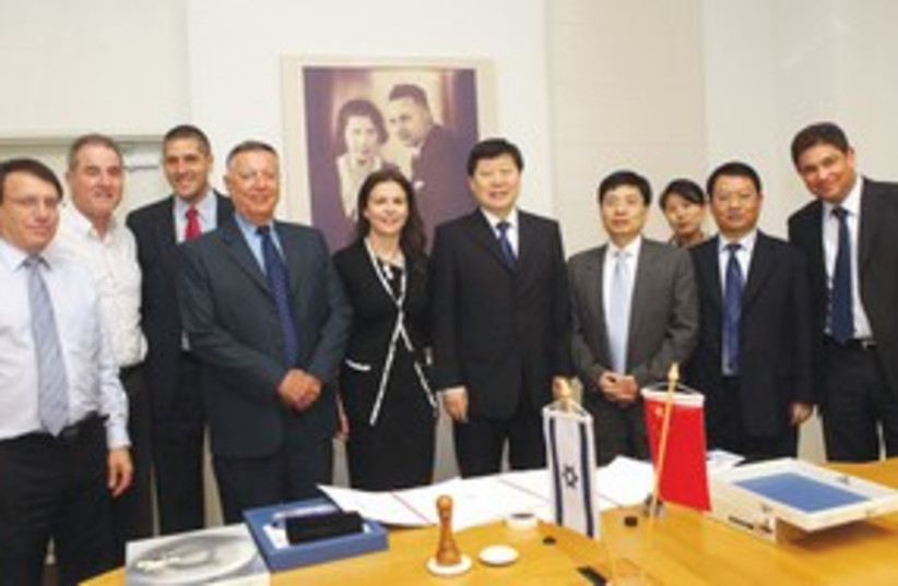 STRAUSS GROUP chairwoman Ofra Strauss with Chinese 311 (photo credit: Sivan Farig)