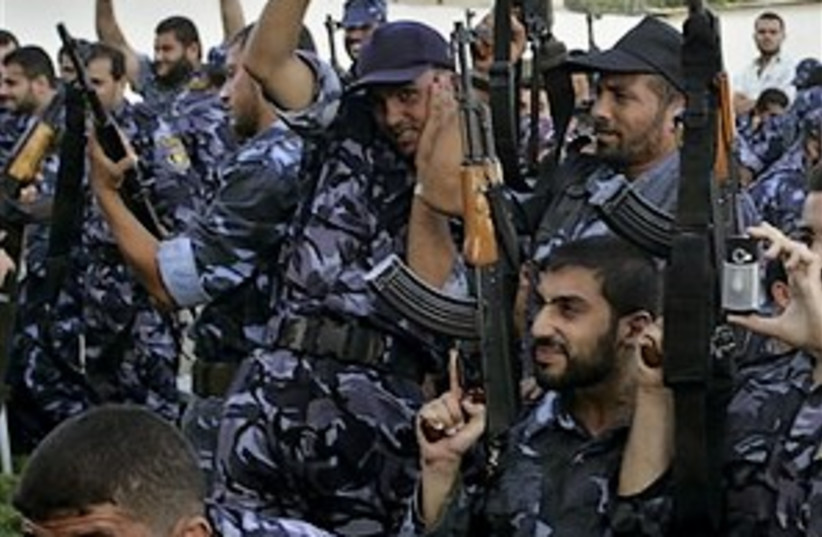 Hamas guns in air 298.88 (photo credit: AP)