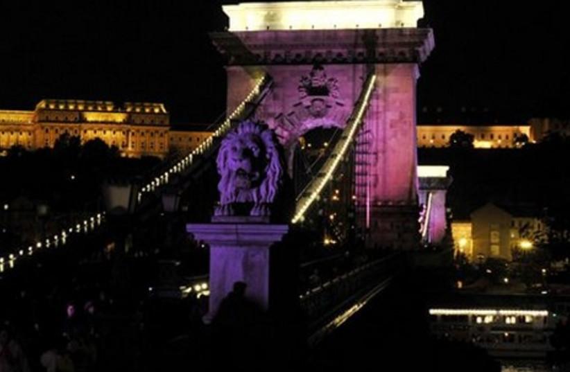 Chain Bridge lit up in Pink