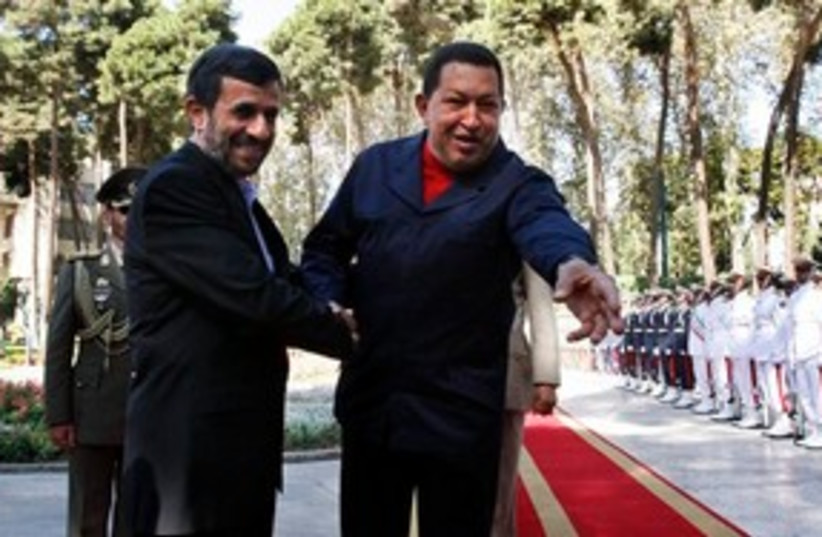 311_ahmadinejad, chavez goes for the grab (photo credit: Associated Press)