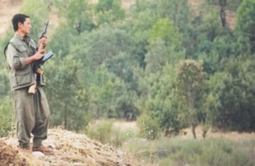 Kurdish Rebel 311 (photo credit: Warrick Page)