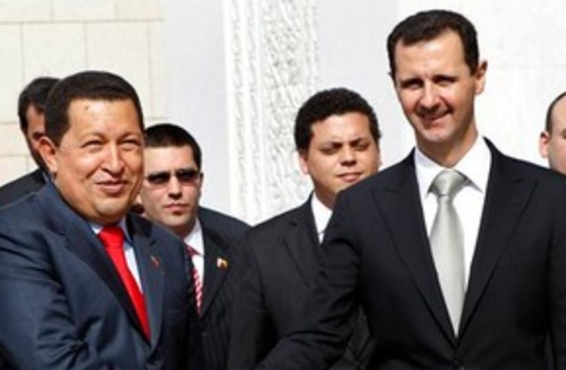 Chavez Assad shaking hands 311 (photo credit: AP Photo/Hussein Malla)