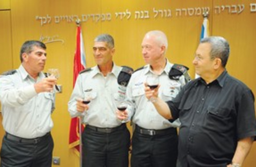 Russo, Galant, Ashkenaza and Barak toast wine 311 (photo credit: IDF Spokesman)