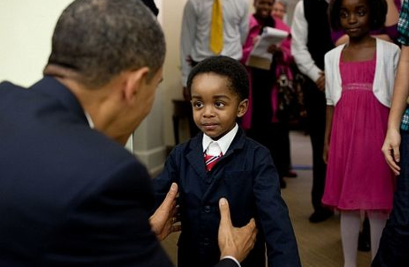 President Barack Obama greets a young visitor