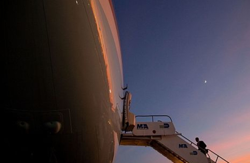 President Barack Obama boards Air Force One