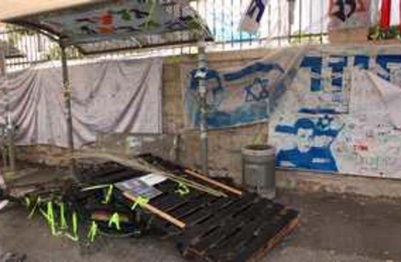 Schalit tent vandalism 311 (photo credit: Marc Israel Sellem)