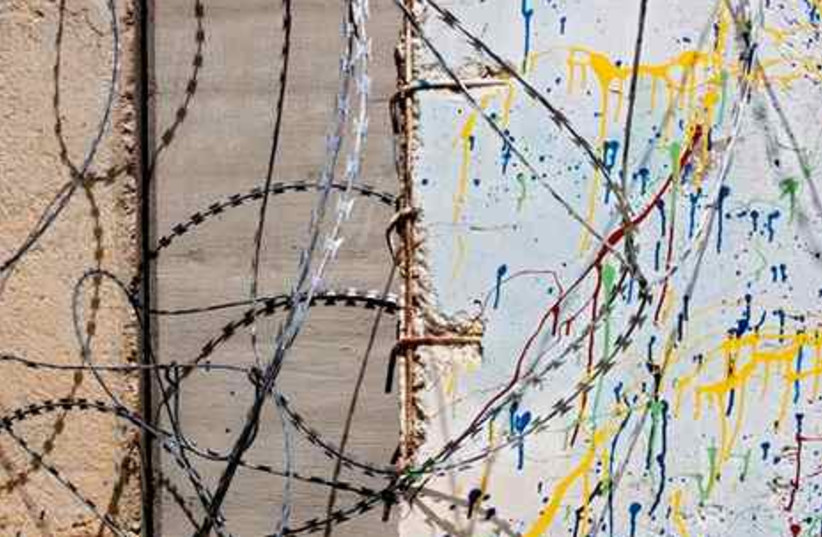 Concrete wall and barb-wire