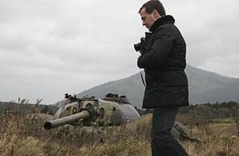 Medvedev visits one of the Russian-held islands claimed by J (photo credit: Associated Press)