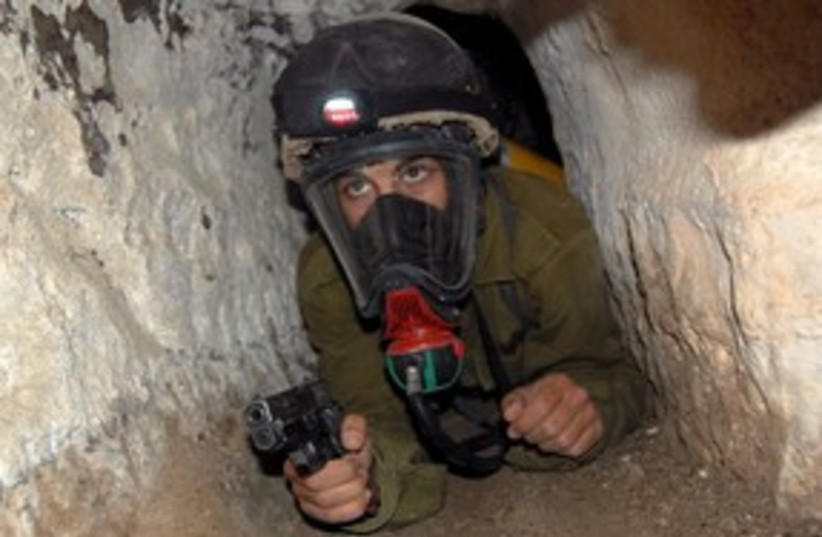 Soldier in gas mask and gun 311 (photo credit: IDF)