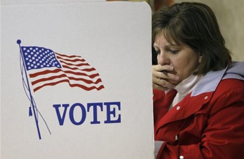 A woman studies her ballot, Nov. 2 2010.
