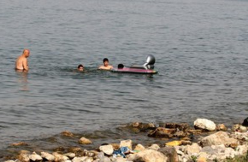 people swimming in Kinneret 311 (photo credit: Ariel Jerozolimski)