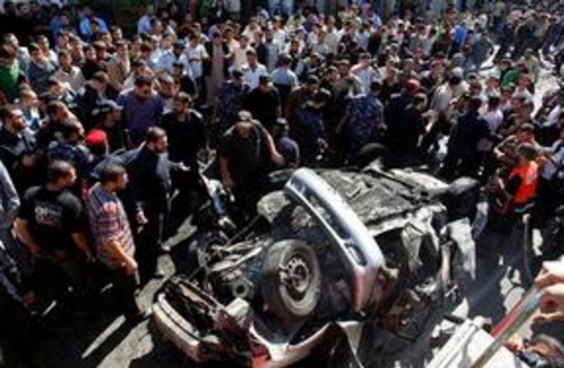 Gaza explosion in car with crowd (photo credit: ASSOCIATED PRESS)